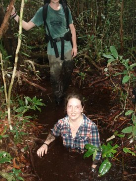 Sara Thornton down a peat hole in the Sabangau Peat-swamp Forest.