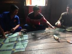 Being shown local fishing traps in Pusaka (Taruna Jaya). Photo by Sara Thornton.