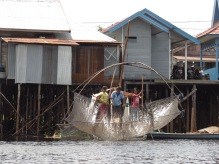 A family of fishers checking their catch on the Sabangau River. Photo by Sara Thornton,